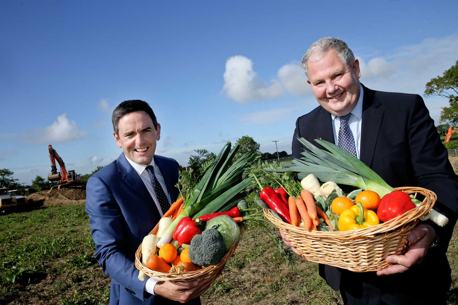 17/08/2015 NO REPRO FEE, MAXWELLS DUBLIN. 100 NEW JOBS AND 100 CONSTRUCTION JOBS TO BE CREATED BY BALLYMAGUIRE FOODS IN NEW WORLD CLASS FOOD PLANT Pic shows: (l to r) Edward Spelman, MD of Ballymaguire Foods with Michael Hoey Chairman Ballymaguire Foods on site where work has started on the new food plant. !00 Jobs to be housed in new state of the art 70,000 sq ft food plant which will nearly treble production for the UK market and the large catering sector . Ballymaguire Foods currently employs 150 people in Lusk and produces 150,000 meals a year . 100 new jobs are to be based in a new state of the art food plant created by Lusk based Ballymaguire Foods. The new jobs which will greatly bolster the existing workforce of 150 will be worth just over €4m to thelocal economy and will include graduate positions in sales and marketing as well as food scientists and technicians, R+D, chefs, cooks and general operatives with a further 100 jobs being generated in the construction of the new food plant which will take nine months to complete. PIC: NO FEE, MAXWELLS. For more info Brian Purcell Big Picture Communications +353 87 9678921 brian@bpcommunications.ie